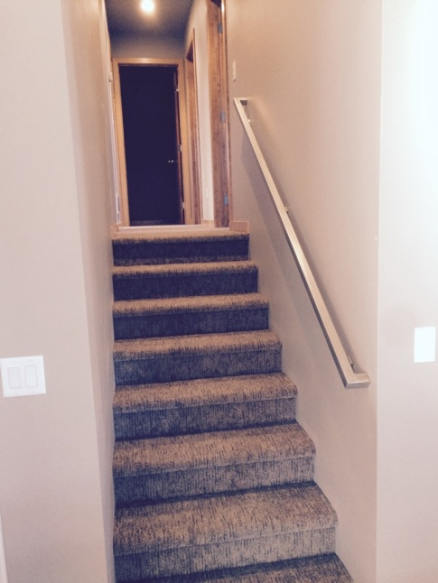 Stairs to bedrooms, bathrooms, laundry.