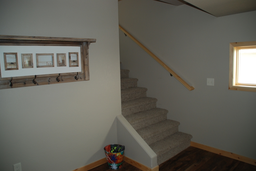 New stairs to additional bedrooms and a bathroom