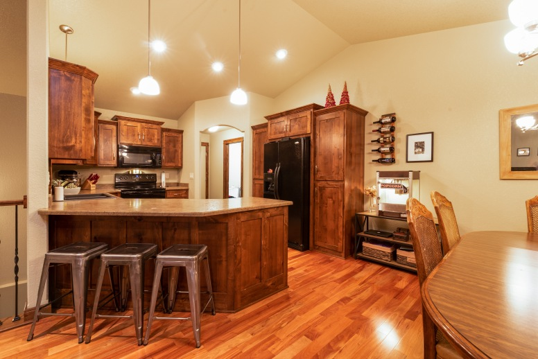 Counter seating leads to the custom kitchen and back entry.