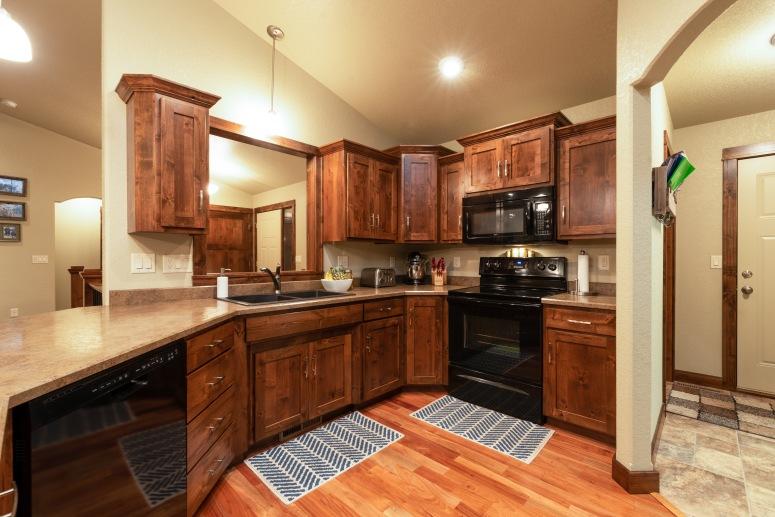 Custom knotty alder cabinetry and hardwood floors