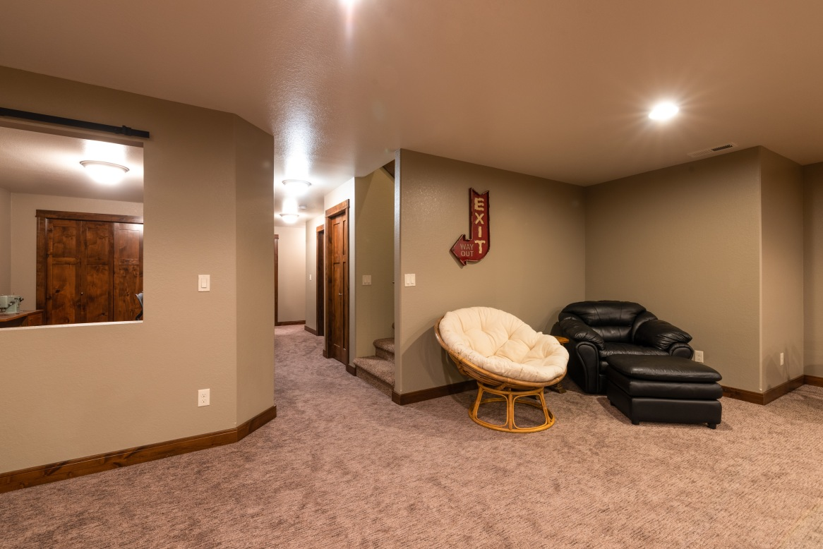 Lower level family room, with the barn-door privacy closure for the office and ready for your bar install.