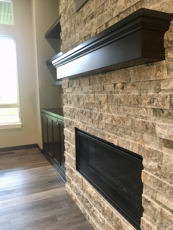 Details on the stone hearth and custom mantle.